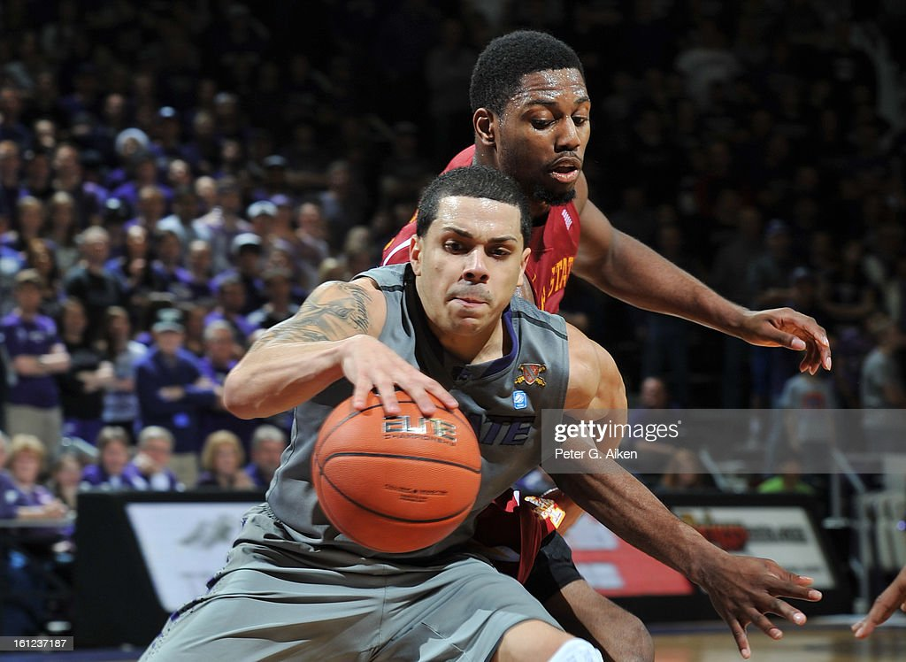 Guard Angel Rodriguez #13 of the Kansas State Wildcats reaches for the ball against forward Melvin Ejim #3 of the Iowa State Cyclones during the second half on February 9, 2013 at Bramlage Coliseum in Manhattan, Kansas. Kansas State defeated Iowa State 79-70.