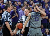 Guard Angel Rodriguez of the Kansas State Wildcats reacts after getting hit in the face during the second half against the Kansas Jayhawks on...