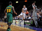 Guard Angel Rodriguez of the Kansas State Wildcats saves the ball from going out of bounds as guard Pierre Jackson of the Baylor Bears looks on...