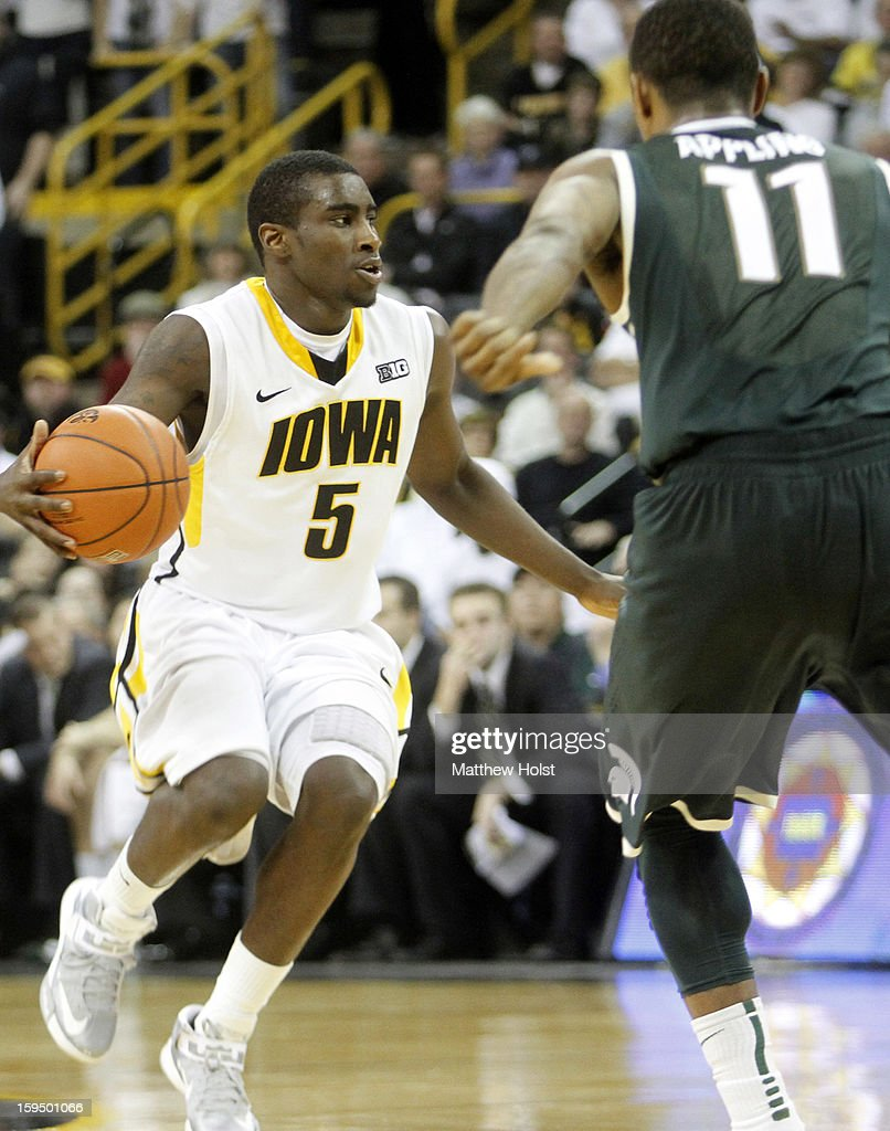 Guard Anthony Clemmons #5 of the Iowa Hawkeyes brings the ball down the court during the second half against guard Keith Appling #11 of the Michigan State Spartans on January 10, 2013 at Carver-Hawkeye Arena in Iowa City, Iowa. Michigan State won 62-59.