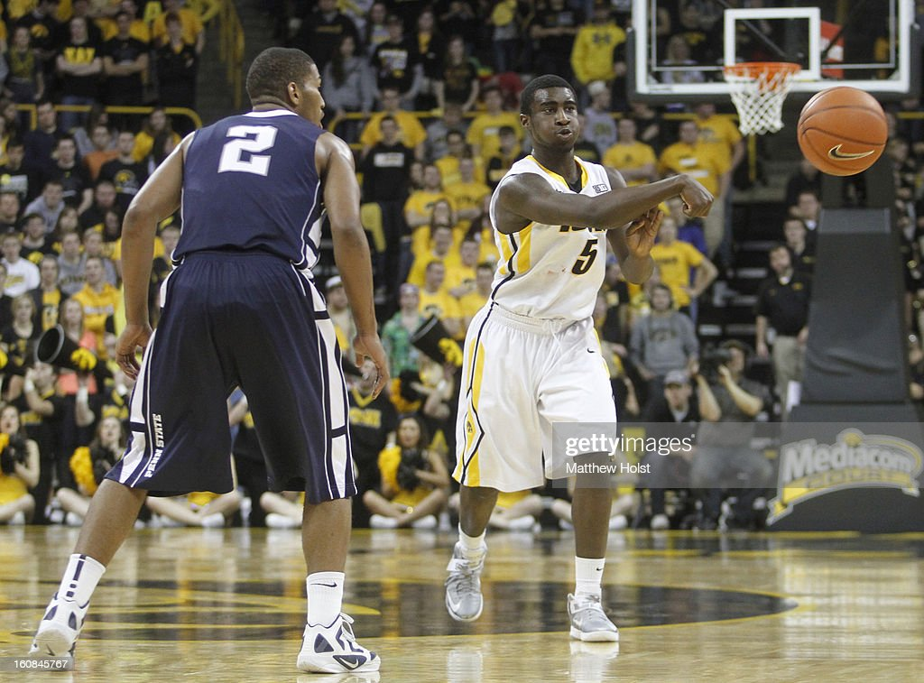 Guard Anthony Clemmons #5 of the Iowa Hawkeyes brings the ball down the court during the second half against guard D.J. Newbill #2 of the Penn State Nittany Lions on January 31, 2013 at Carver-Hawkeye Arena in Iowa City, Iowa. Iowa won 76-67.