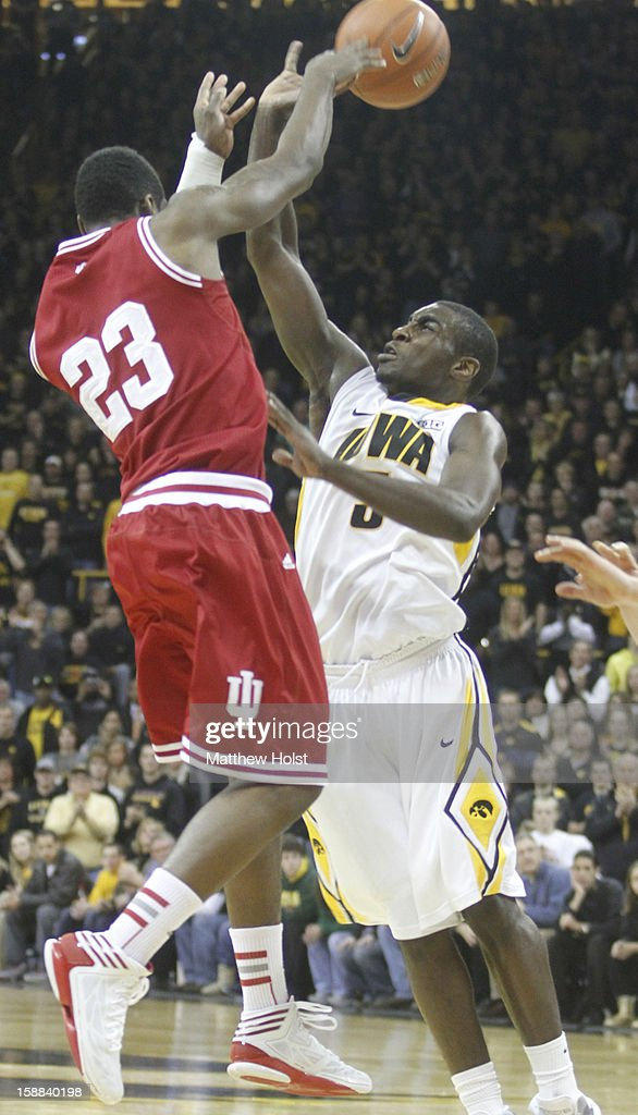 Guard Anthony Clemmons #5 of the Iowa Hawkeyes defends during the second half against guard Remy Abell #23 of the Indiana Hoosiers on December 31, 2012 at Carver-Hawkeye Arena in Iowa City, Iowa. Indiana won 69-65.