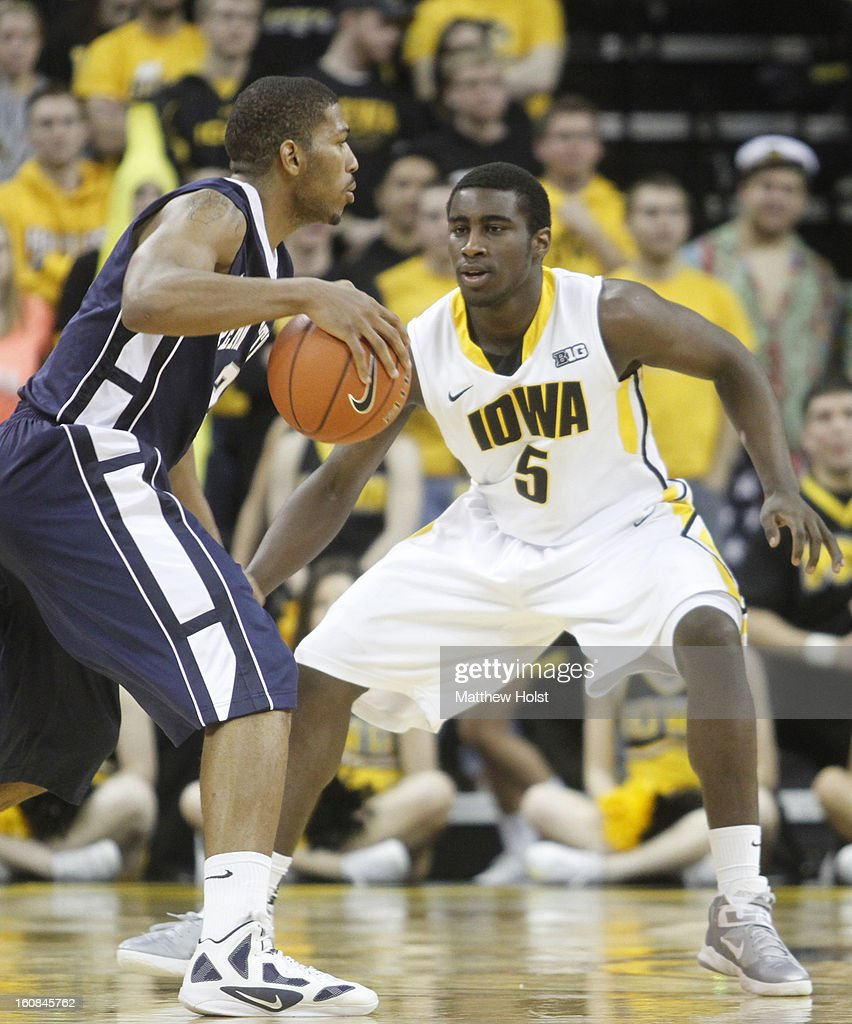 Guard Anthony Clemmons #5 of the Iowa Hawkeyes defends during the second half against guard D.J. Newbill #2 of the Penn State Nittany Lions on January 31, 2013 at Carver-Hawkeye Arena in Iowa City, Iowa. Iowa won 76-67.