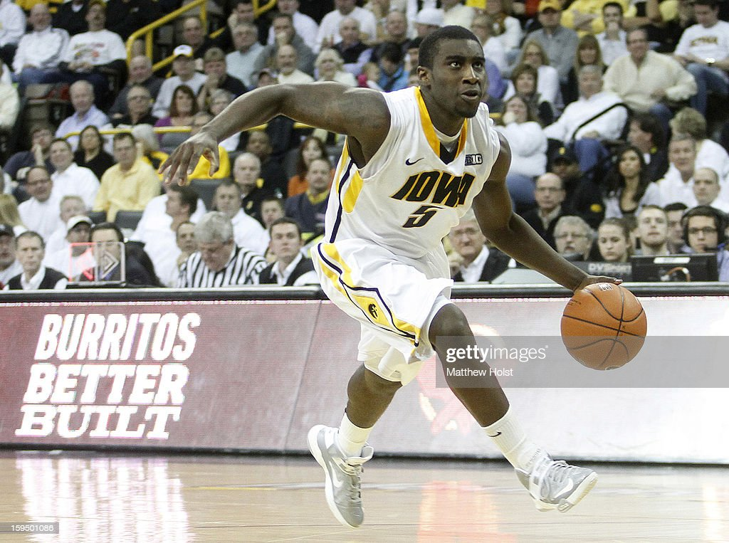 Guard Anthony Clemmons #5 of the Iowa Hawkeyes drives down the court during the second half against the Michigan State Spartans on January 10, 2013 at Carver-Hawkeye Arena in Iowa City, Iowa. Michigan State won 62-59.