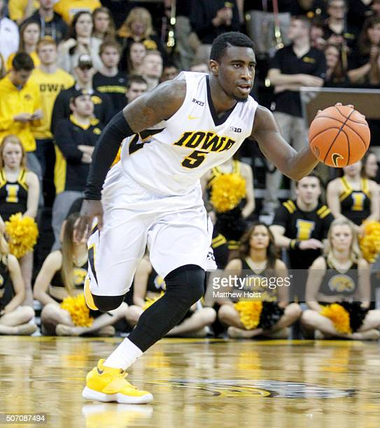 Guard Anthony Clemmons of the Iowa Hawkeyes drives down the court against the Purdue Boilermakers in the second half on January 24 2016 at...