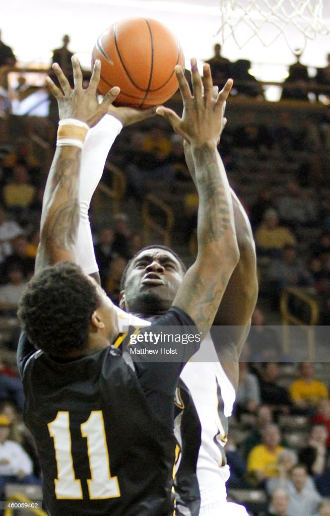 Guard Anthony Clemmons #5 of the Iowa Hawkeyes goes to the basket against guard <a gi-track='captionPersonalityLinkClicked' href=/galleries/search?phrase=Charles+Taylor&family=editorial&specificpeople=240314 ng-click='$event.stopPropagation()'>Charles Taylor</a> #11 of the UMBC Retrievers, in the second half on December 6, 2014 at Carver-Hawkeye Arena, in Iowa City, Iowa.