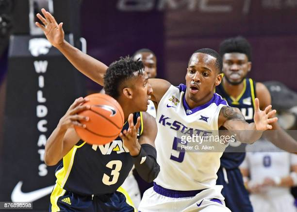 Guard Barry Brown of the Kansas State Wildcats defends against guard Gino Littles of the Northern Arizona Lumberjacks during the second half on...