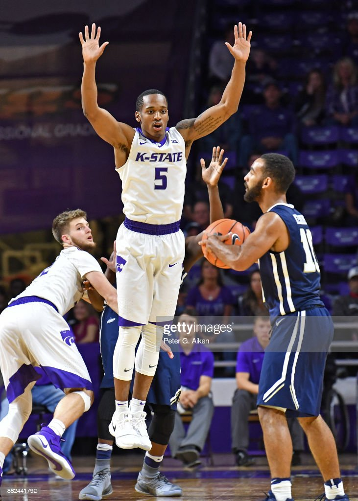 Guard Barry Brown #5 of the Kansas State Wildcats defends guard Sam Kearns #10 of the Oral Roberts Golden Eagles during the second half on November 29, 2017 at Bramlage Coliseum in Manhattan, Kansas.