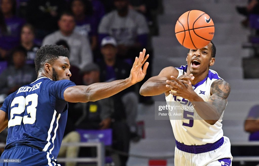 Guard Barry Brown #5 of the Kansas State Wildcats deflects the ball away from forward Emmanuel Nzekwesi #23 of the Oral Roberts Golden Eagles during the second half on November 29, 2017 at Bramlage Coliseum in Manhattan, Kansas.