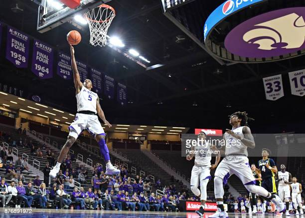 Guard Barry Brown of the Kansas State Wildcats drives in for a lay up against the Northern Arizona Lumberjacks during the second half on November 20...