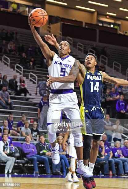 Guard Barry Brown of the Kansas State Wildcats drives in for a layup against guard Karl Harris of the Northern Arizona Lumberjacks during the second...