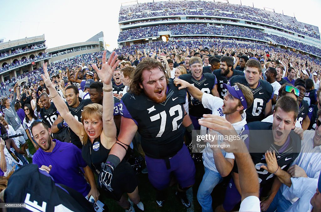 Guard Bobby Thompson of the TCU Horned Frogs celebrates with fans on the field after the Horned Frogs beat the Oklahoma Sooners 3733 at Amon G Carter...