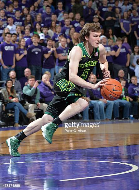 Guard Brady Heslip of the Baylor Bears heads up court with the ball against the Kansas State Wildcats during the second half on March 8 2014 at...