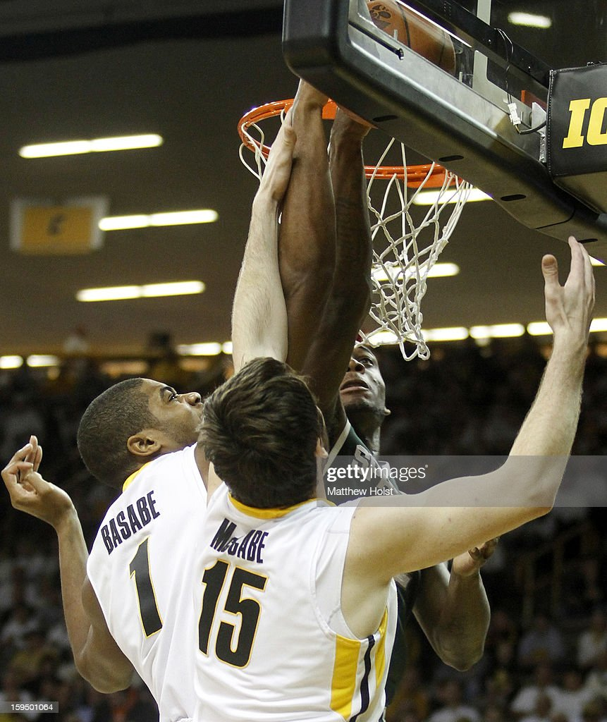Guard Branden Dawson #22 of the Michigan State Spartans goes to the basket during the first half against forwards Melsahn Basabe #1 and Zach McCabe #15 of the Iowa Hawkeyes on January 10, 2013 at Carver-Hawkeye Arena in Iowa City, Iowa. Michigan State won 62-59.