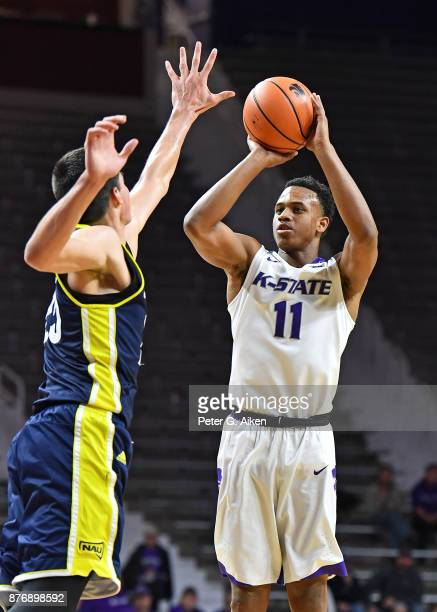 Guard Brian Patrick of the Kansas State Wildcats shoots the ball against forward Brooks Debisschop of the Northern Arizona Lumberjacks during the...