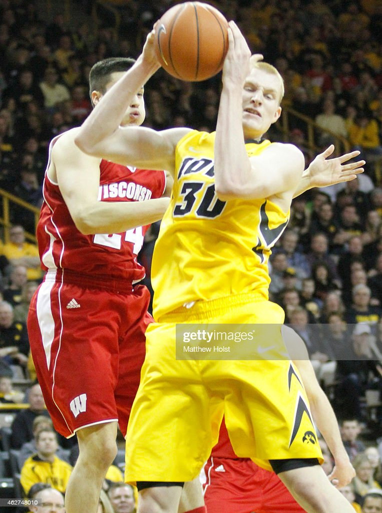 Guard <a gi-track='captionPersonalityLinkClicked' href=/galleries/search?phrase=Bronson+Koenig&family=editorial&specificpeople=9510843 ng-click='$event.stopPropagation()'>Bronson Koenig</a> #24 of the Wisconsin Badgers battles for a rebound with forward <a gi-track='captionPersonalityLinkClicked' href=/galleries/search?phrase=Aaron+White+-+Basketball+Player&family=editorial&specificpeople=14619648 ng-click='$event.stopPropagation()'>Aaron White</a> #30 of the Iowa Hawkeyes, in the first half on January 31, 2015 at Carver-Hawkeye Arena, in Iowa City, Iowa.