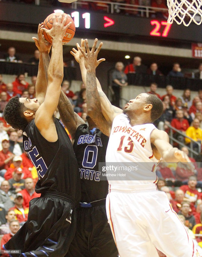 Guard Bryce DejeanJones of the Iowa State Cyclones battles for a rebound with guards Jalen Brown and Kevin Ware of the Georgia State Panthers in the...