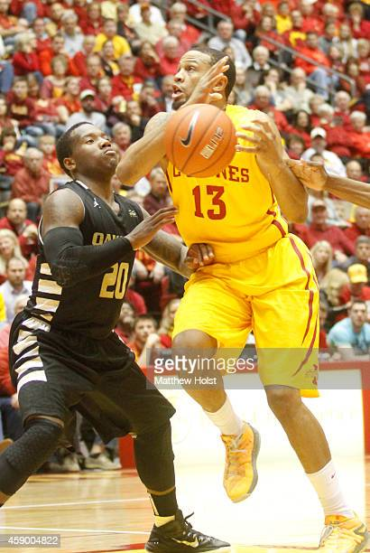 Guard Bryce DejeanJones of the Iowa State Cyclones is fouled by guard Kahlil Felder of the Oakland Golden Grizzlies in the second half on November 14...