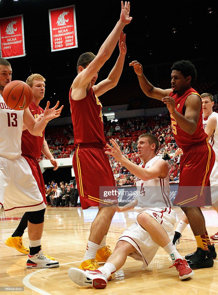 Guard Bryce Leavitt #4 of the Washington State Cougars falls to the floor during the second half of the game against the USC Trojans at Beasley Coliseum on March 9, 2013 in Pullman, Washington.