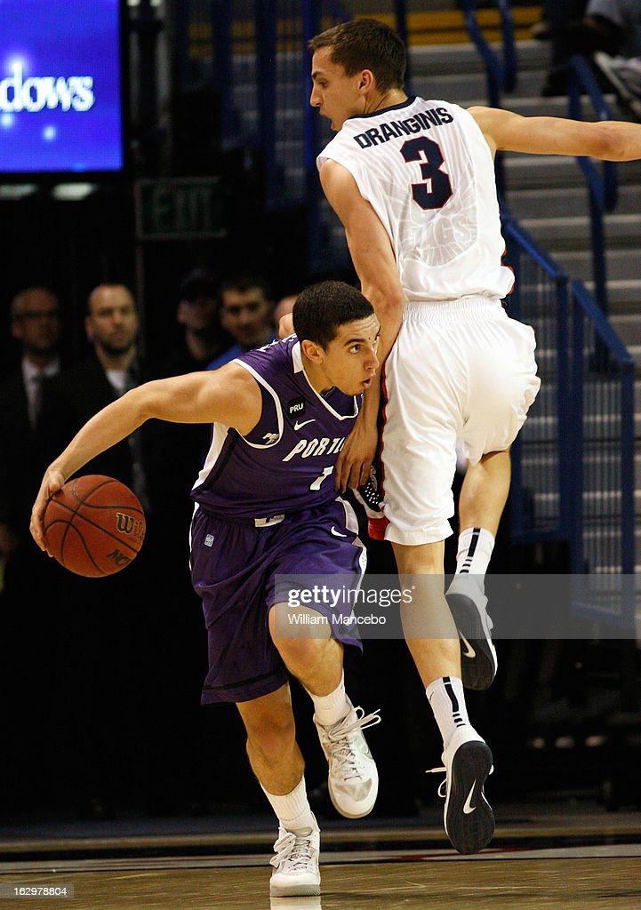 Guard Bryce Pressley #1 of the Portland Pilots drives against guard Kyle Dranginis #3 of the Gonzaga Bulldogs during the second half of the game at McCarthey Athletic Center on March 2, 2013 in Spokane, Washington.