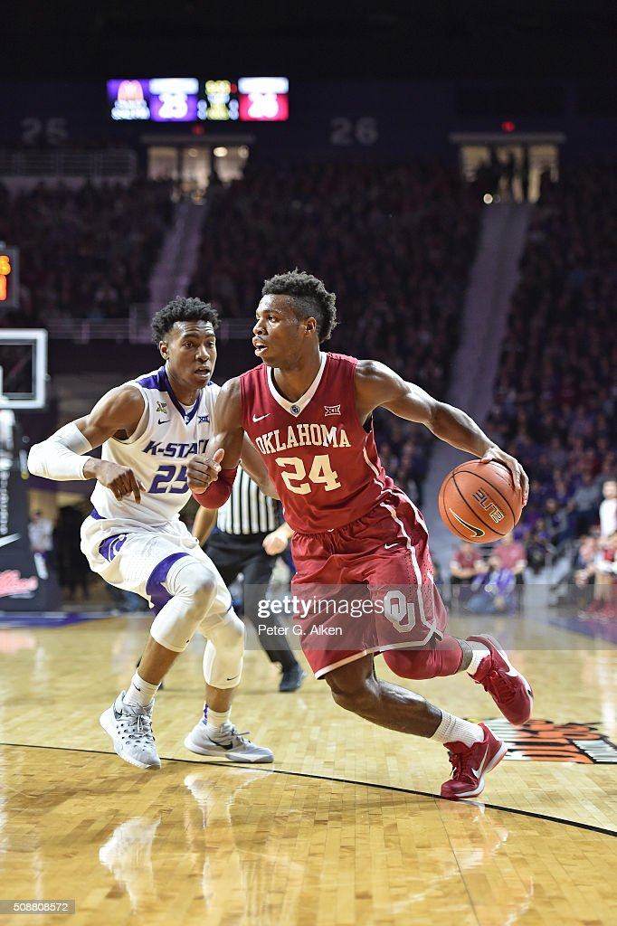 Guard Buddy Hield of the Oklahoma Sooners drives against guard Wesley Iwundu of the Kansas State Wildcats during the first half on February 6 2016 at...