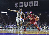 Guard Buddy Hield of the Oklahoma Sooners drives with the ball against guard Wesley Iwundu of the Kansas State Wildcats during the first half on...