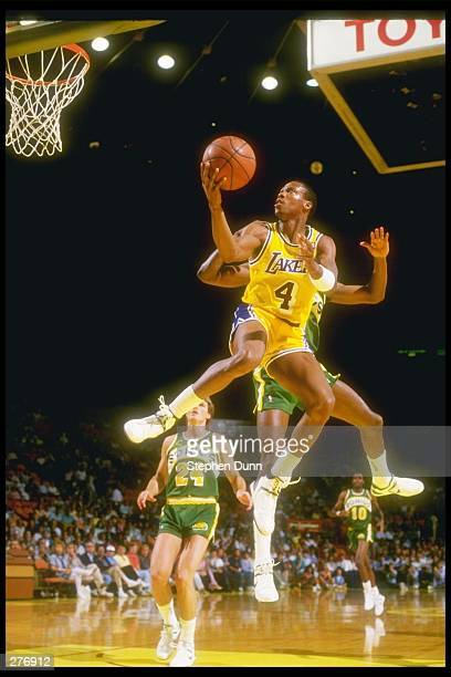 Guard Byron Scott of the Los Angeles Lakers leaps for the hoop over the Seattle SuperSonics during a game at The Forum in Inglewood California...