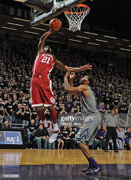 Guard Cameron Clark of the Oklahoma Sooners scores over guard Shane Southwell of the Kansas State Wildcats during the first half on February 19 2011...