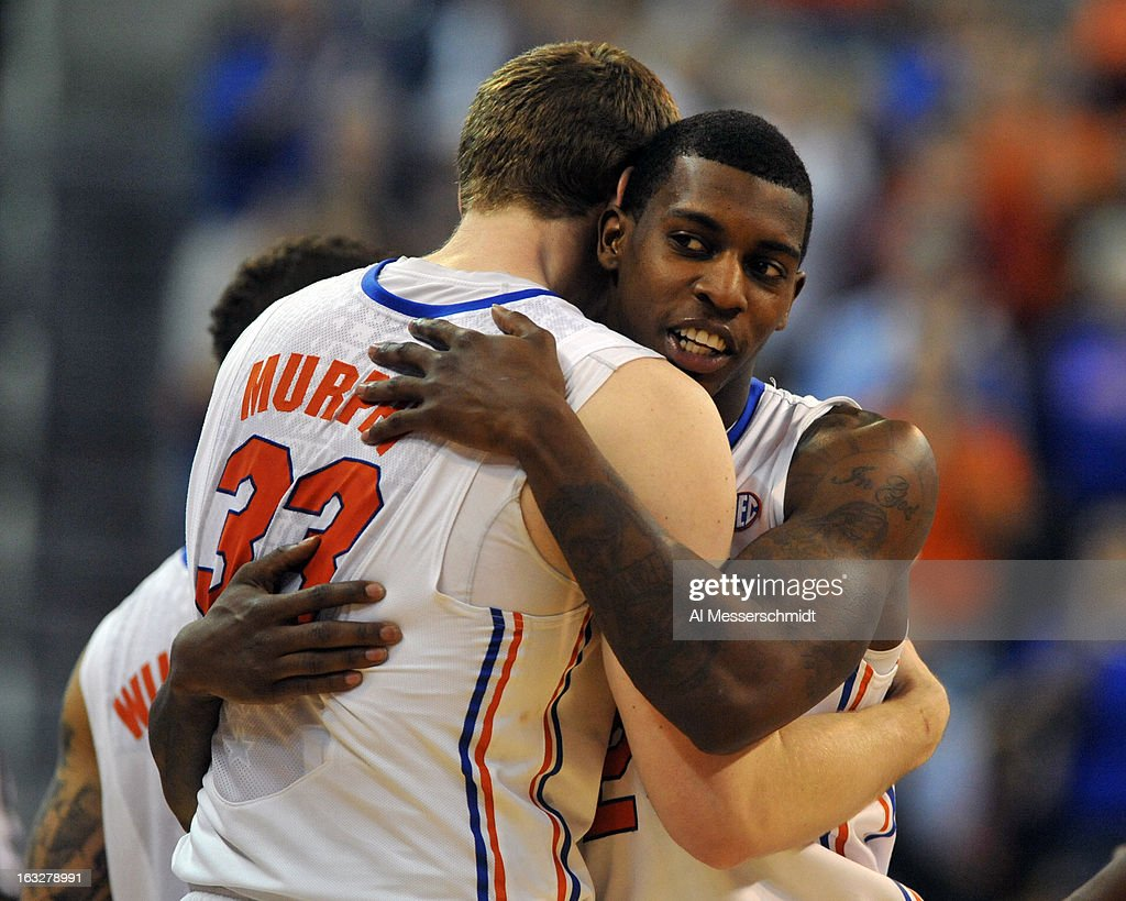 Guard Casey Prather #24 of the Florida Gators hugs forward Erik Murphy #33 after play against the Vanderbilt Commodores March 6, 2013 at Stephen C. O'Connell Center in Gainesville, Florida. Murphy played in his last home game for Florida.