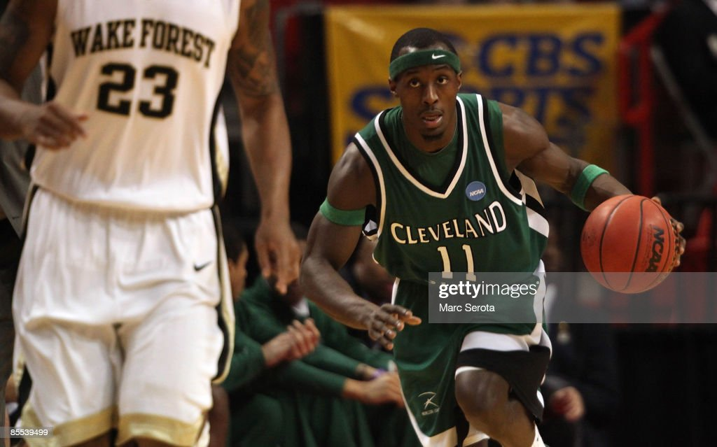 Guard Cedric Jackson of the Cleveland State University Vikings moves the ball up court past forward James Johnson of Wake Forest Demon Deacons during...
