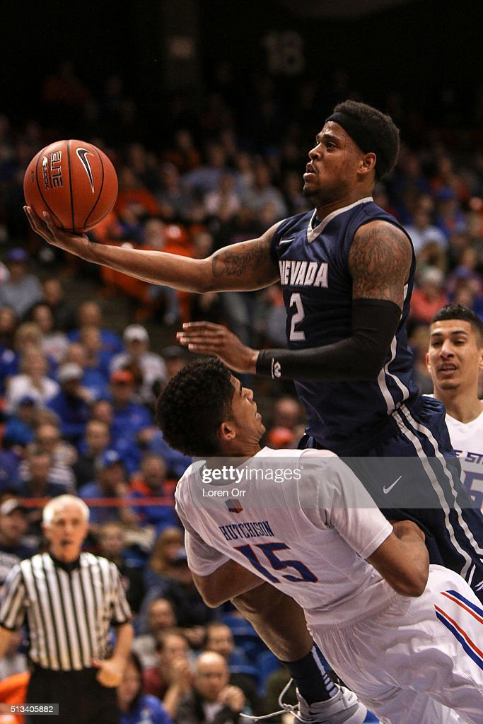 Guard Chandler Hutchison of the Boise State Broncos takes a charge from guard Tyron Criswell of the Nevada Wolf Pack during first half action on...