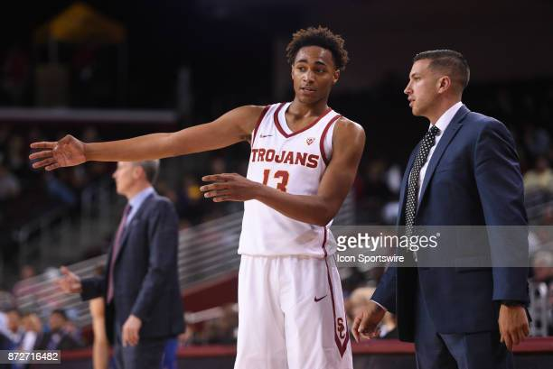 USC guard Charles O'Bannon Jr talks with USC assistant coach Chris Capko during a college basketball game between the Cal State Fullerton Titans and...