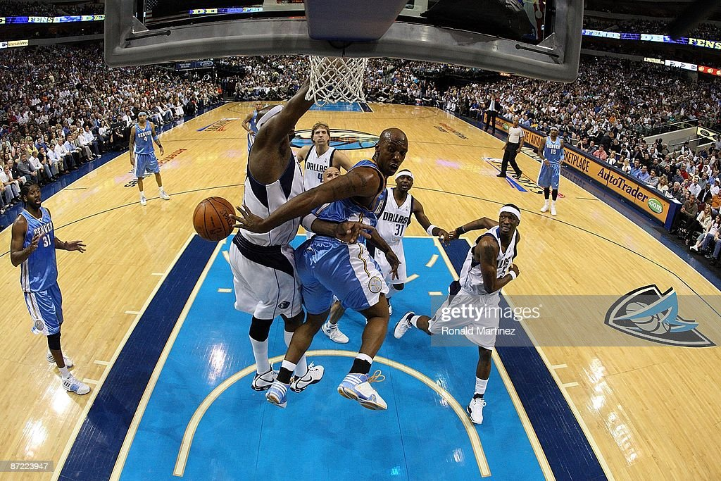 Guard Chauncey Billups #7 of the Denver Nuggets takes a shot against Erick Dampier #25 of the Dallas Mavericks in Game Four of the Western Conference Semifinals during the 2009 NBA Playoffs at American Airlines Center on May 11, 2009 in Dallas, Texas.