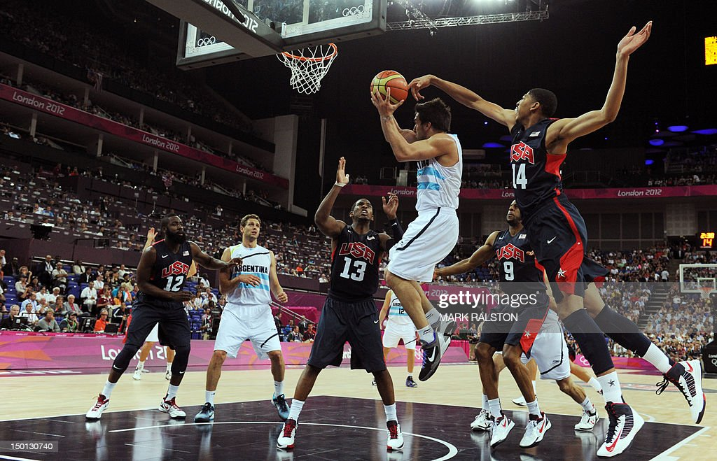 US guard Chris Paul and US centre Anthony Davis challenge Argentinian forward Facundo Campazzo as he jumps to score during the London 2012 Olympic...