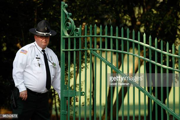 A guard closes the gate to Magnolia Lane along Washington Road in front of Augusta National Golf Club on April 4 2010 in Augusta Georgia The Masters...