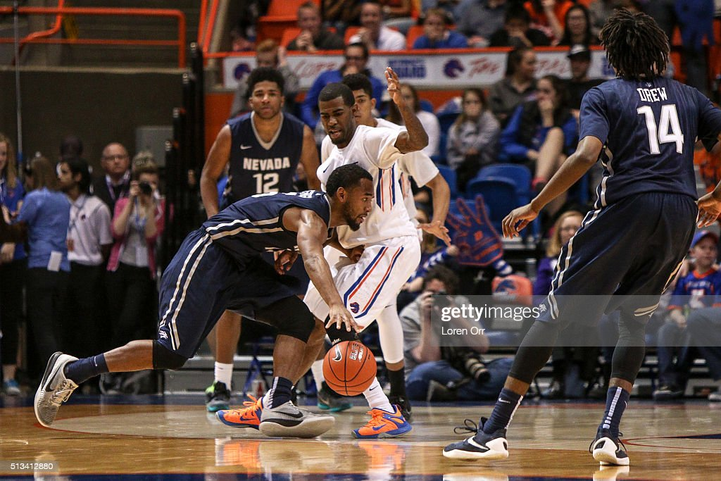 Guard D J Fenner of the Nevada Wolf Pack dribbles headlong into guard Mikey Thompson of the Boise State Broncos during second half action on March 2...