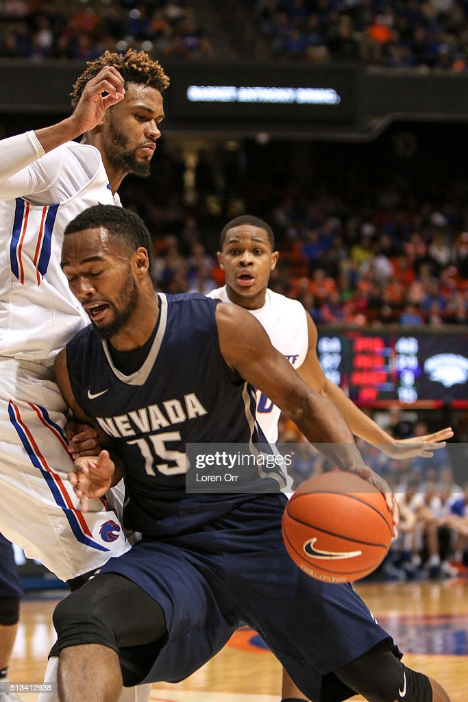 Guard D J Fenner of the Nevada Wolf Pack drives into forward James Webb III of the Boise State Broncos during second half action on March 2 2016 at...