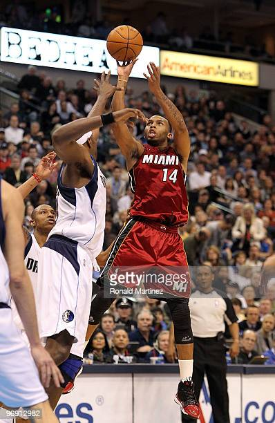 Guard Daequan Cook of the Miami Heat takes a shot against Brendan Haywood of the Dallas Mavericks on February 20 2010 at American Airlines Center in...