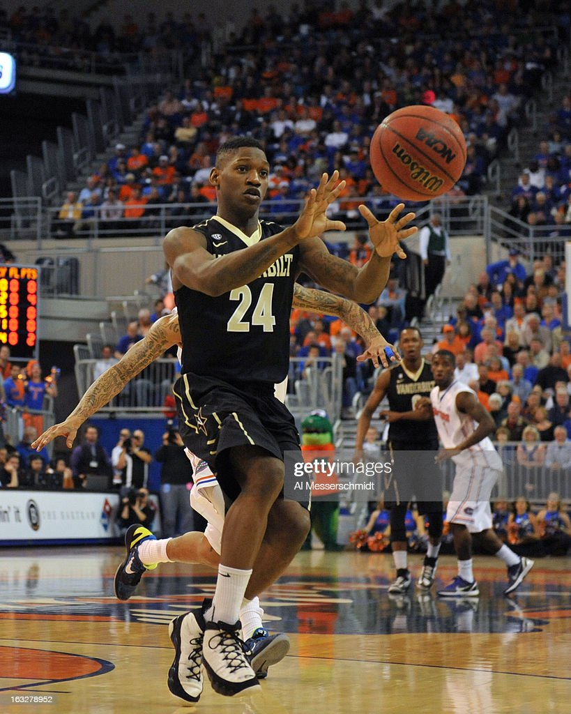 Guard Dai-Jon Parker #24 of the Vanderbilt Commodores takes a pass against the Florida Gators March 6, 2013 at Stephen C. O'Connell Center in Gainesville, Florida.