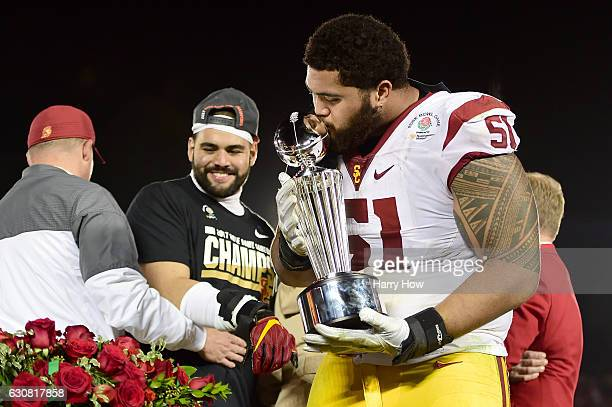 Guard Damien Mama of the USC Trojans celebrates with the 2017 Rose Bowl trophy after defeating the Penn State Nittany Lions 5249 to win the 2017 Rose...