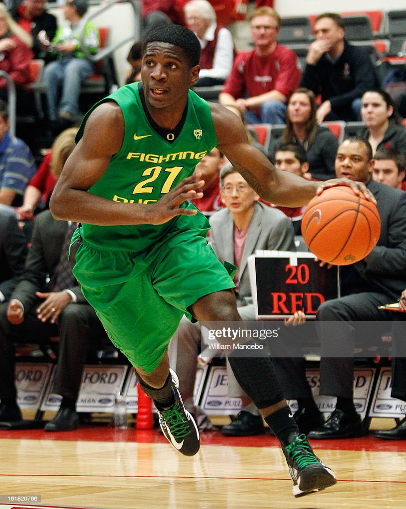 Guard Damyean Dotson #21 of the Oregon Ducks drives toward the hoop during the game against the Washington State Cougars at Beasley Coliseum on February 16, 2013 in Pullman, Washington.