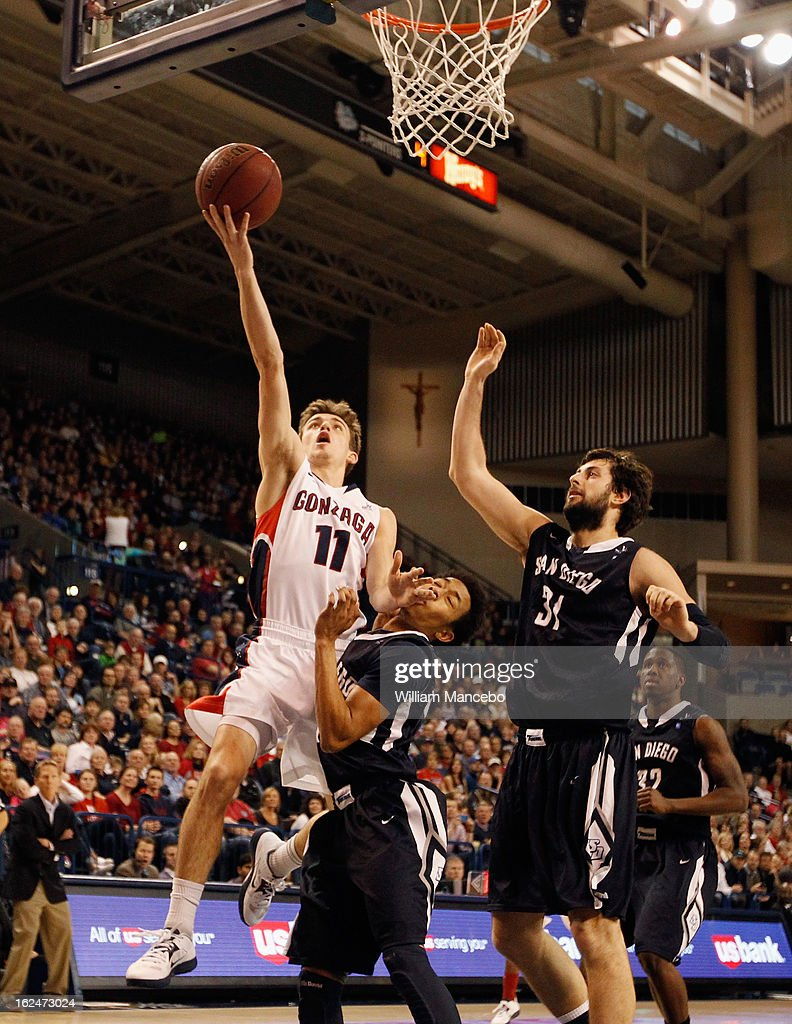 Guard David Stockton #11 of the Gonzaga Bulldogs drives to the hoop against Christopher Anderson #00 of the San Diego Toreros while John Sinis #31 defends during the second half of the game at McCarthey Athletic Center on February 23, 2013 in Spokane, Washington.