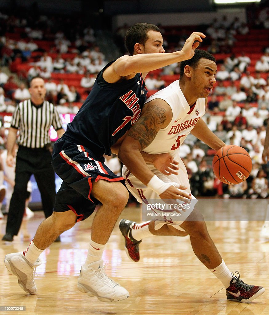 Guard DaVonte Lacy #3 of the Washington State Cougars drives past guard Gabe York #1 of the Arizona Wildcats during the game at Beasley Coliseum on February 2, 2013 in Pullman, Washington.