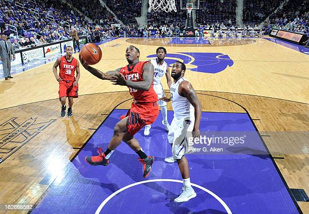 Guard Daylen Robinson of the Texas Tech Red Raiders drives to the basket past forward Thomas Gipson of the Kansas State Wildcats during the second...