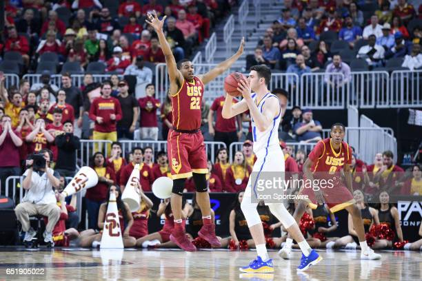 USC guard DeAnthony Melton guards the basketball during the quarterfinal game of the Pac12 Tournament between the UCLA Bruins and the USC Trojans on...
