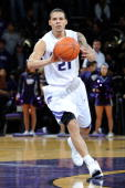 Guard Denis Clemente of the Kansas State Wildcats brings the ball up court against the Xavier Musketeers in the second half on December 8 2009 at...