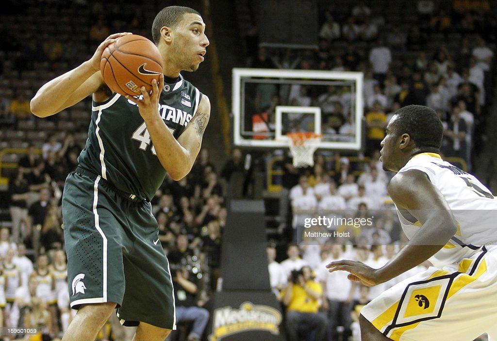 Guard Denzel Valentine #45 of the Michigan State Spartans brings the ball down the court during the first half against guard Anthony Clemmons #5 of the Iowa Hawkeyes on January 10, 2013 at Carver-Hawkeye Arena in Iowa City, Iowa. Michigan State won 62-59.