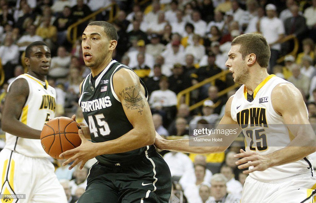 Guard Denzel Valentine #45 of the Michigan State Spartans brings the ball down the court during the first half between guard Anthony Clemmons #5 and forward Eric May #25 of the Iowa Hawkeyes on January 10, 2013 at Carver-Hawkeye Arena in Iowa City, Iowa. Michigan State won 62-59.
