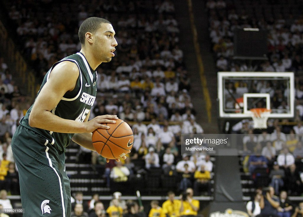 Guard Denzel Valentine #45 of the Michigan State Spartans looks for a shot during the second half against the Iowa Hawkeyes on January 10, 2013 at Carver-Hawkeye Arena in Iowa City, Iowa. Michigan State won 62-59.