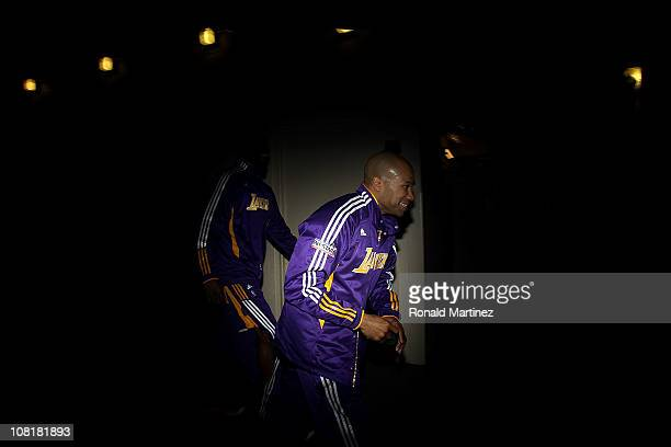 Guard Derek Fisher of the Los Angeles Lakers runs to the court before a game against the Dallas Mavericks at American Airlines Center on January 19...